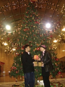 The Hubby and I exchange fake gifts under a Christmas tree in a Kuwaiti mall, 2006